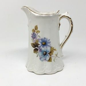 Antique floral pitcher